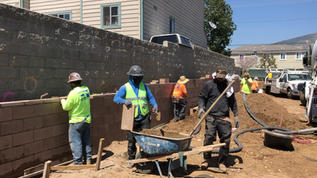 Pumping Concrete Into Retaining Wall