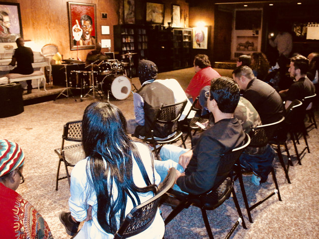 Members learn drumming from professional musicians