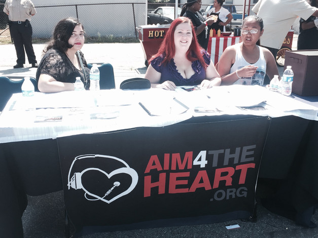 Members Sophie, Colleen and Liz at Aim table Expressive Arts Festival