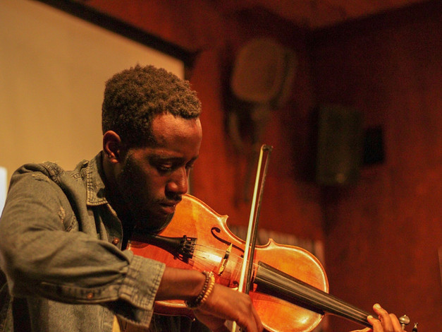 Jeremy Jones plays violin during Change the Tune Event