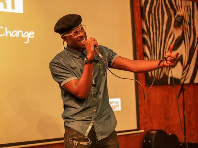 Singer/Songwriter Jarette Romero performs his original song during Change the Tune event