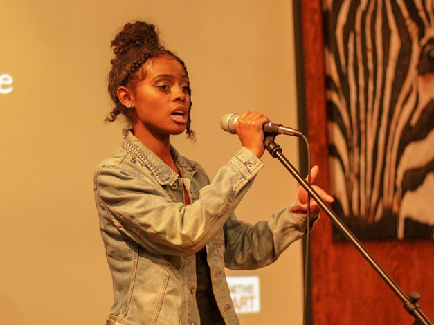 Singer Fana Hues performs at Change the Tune Event
