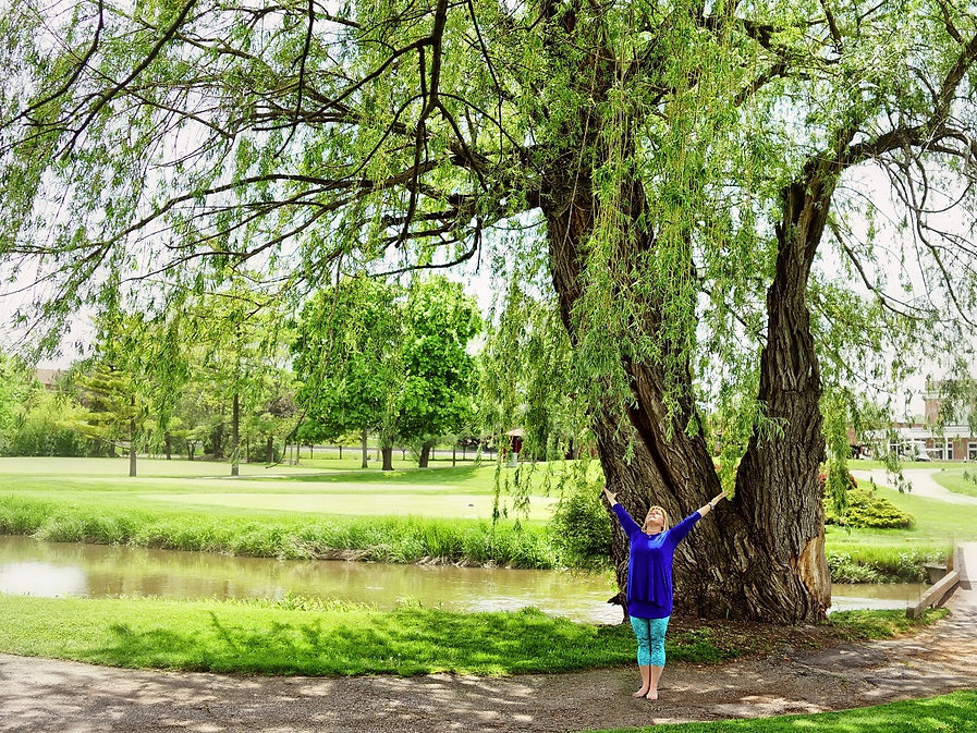 Jody standing at base of willow tree