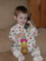 Family and Pet Guide, picture of David McKiddy talking on phone holding sippy cup