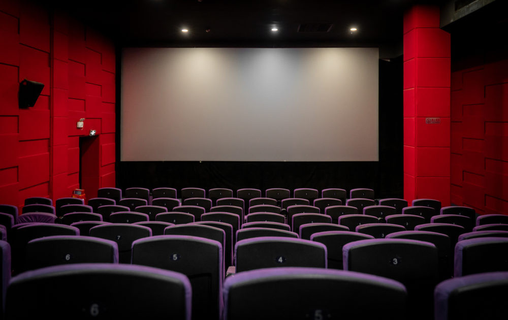 An empty cinema room with a lot of chairs