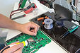 homeguide-man-repairing-led-tv-parts-in-
