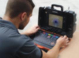 Technician operating SOLOPro+ Control Unit