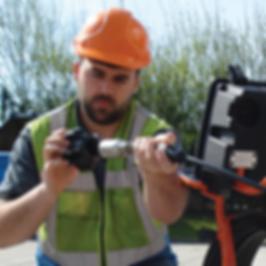 Technician attaching Skid on SOLOPro+ Push Camera