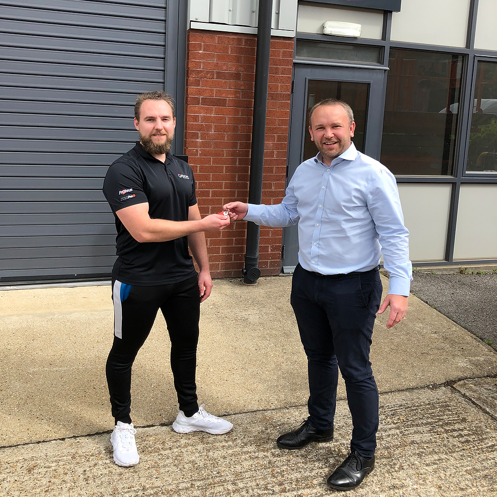 Liam Houghton collects keys to the Southern Service Centre
