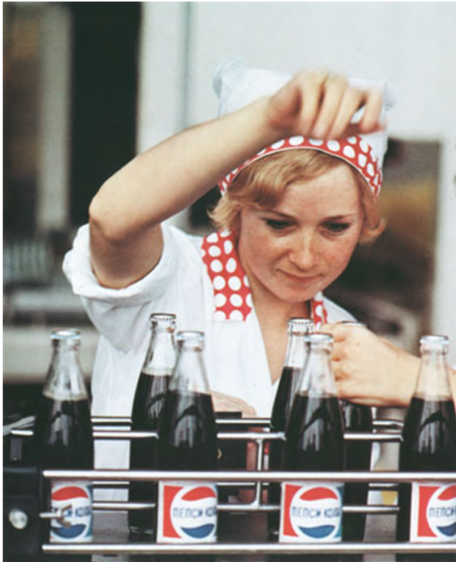 A woman working in a Pepsi factory.