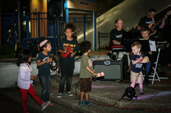 Kids on stage playing percussion