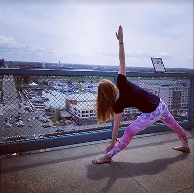 Private Yoga Erie doing yoga with a view of Downtown Erie