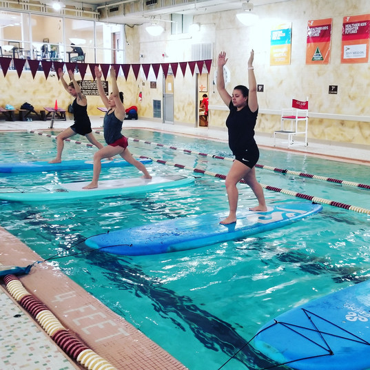 Paddleboard Yoga at the Glenwood YMCA in