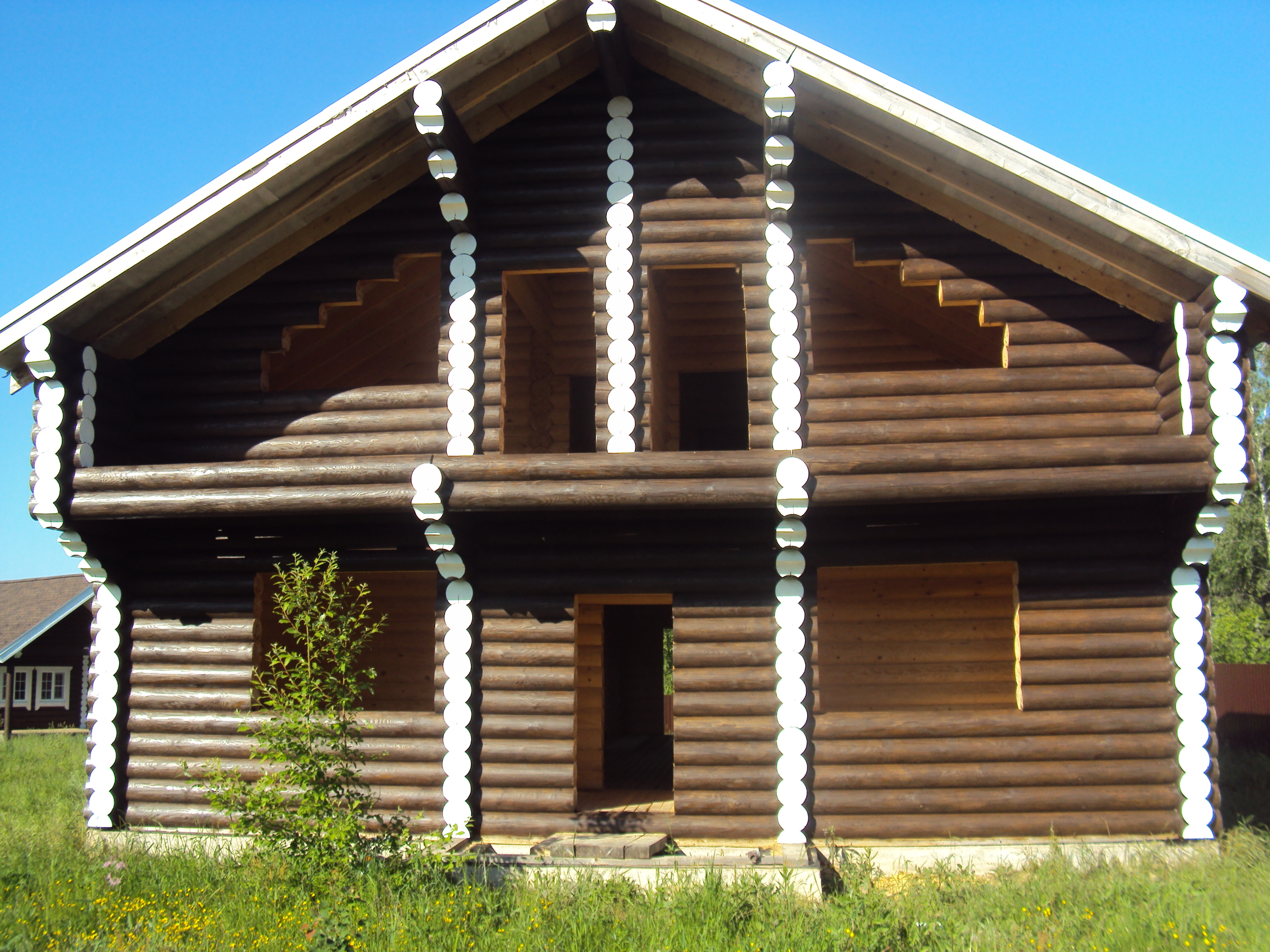 Отделка домов из бревна и бруса