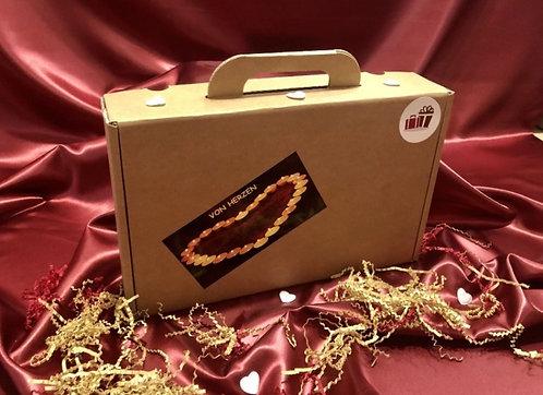 Geschenk Koffer von Herzen, Mit dem Herz schenken
