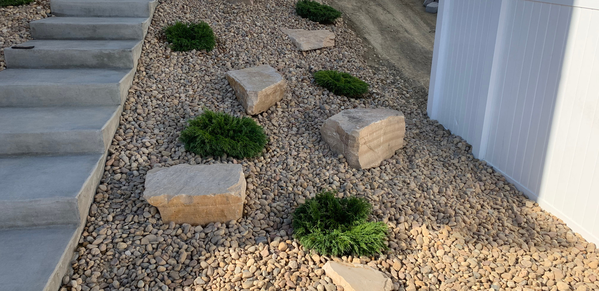 Concrete stairs on side yard