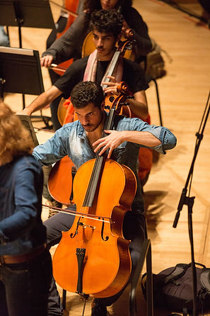Naseem Alatrash leading the Palestinian Youth Orchestra Cello Section
