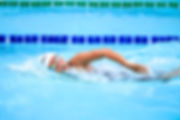 person-swimming-in-body-of-water-1263348