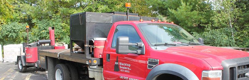New Hampshire Blacktop Sealers road parking lot driveway repair truck auburn photographed by Brandon Latham