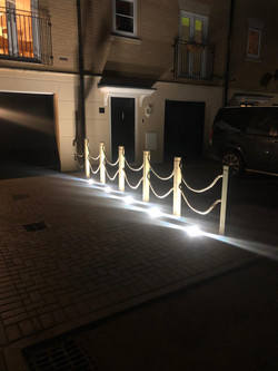 Rope fence with up lights.