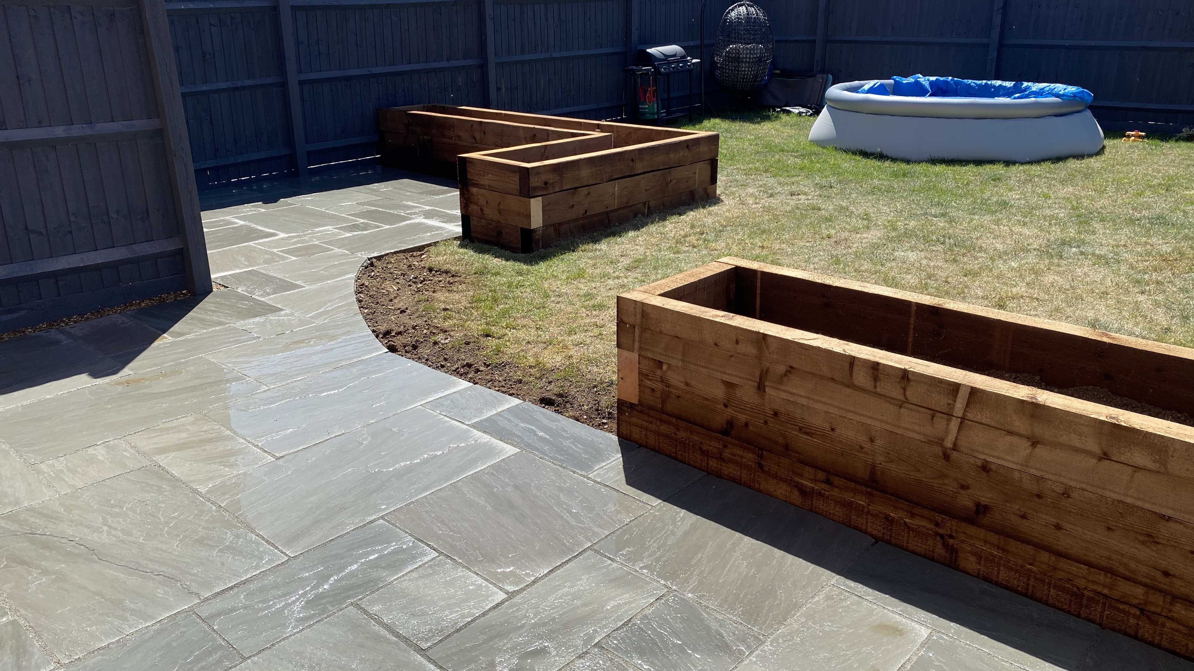 New patio and flower beds.