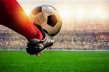 red-soccer-player-kicking-ball-action-st