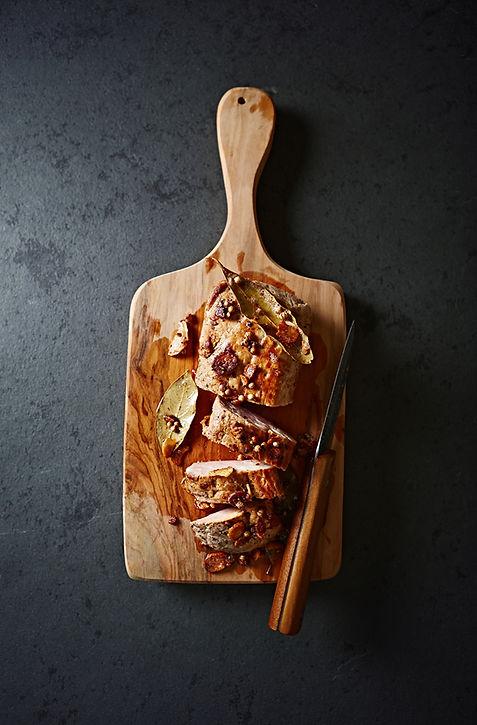 Roasted pork tenderloin on a chopping bo