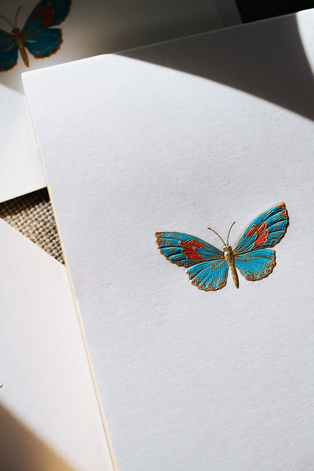 stationary for unique marketing strategies that has a blue and orange butterfly on it