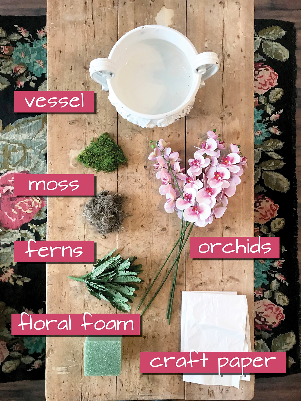 a table displaying all the materials you need to create a faux-flower centerpiece