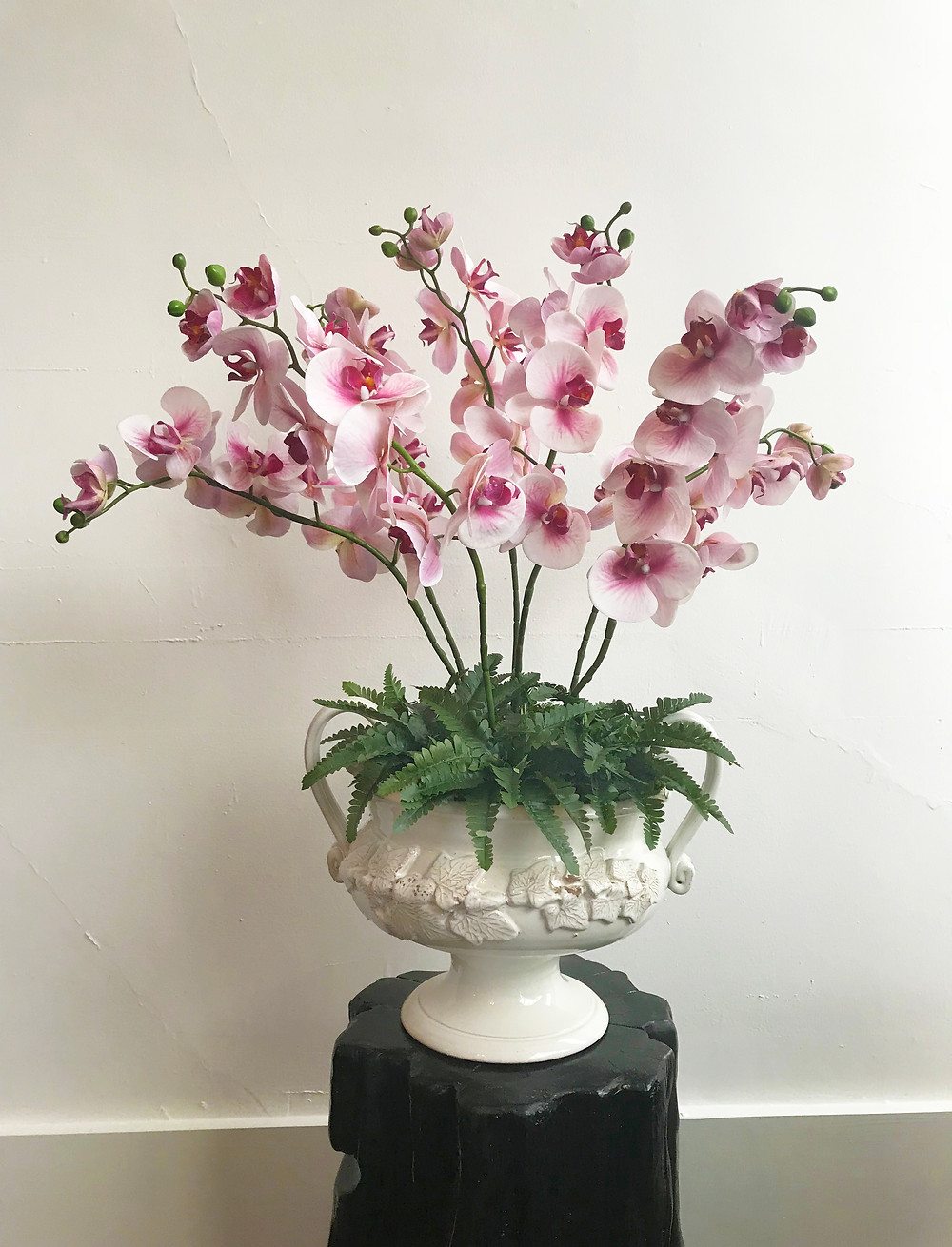 picture of a hand-crafted DIY faux-flower arrangement with orchids