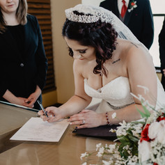 Jordan signing her marriage license on her wedding day.