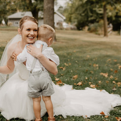 Son hugging his mom on her wedding day.