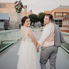 Newlyweds, Jenna and Cody, taking wedding portraits on University of Iowa Campus.