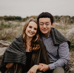 Recently engaged couple Rory and Morgan relaxing by Lake MacBride in Iowa City