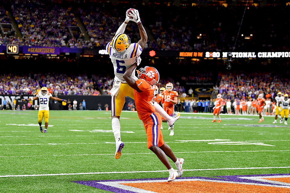 Terrace Marshal jumps up for a ball in the end zone versus Clemson