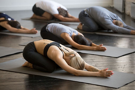 yogis in childs pose