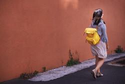 Woman with Yellow Bag