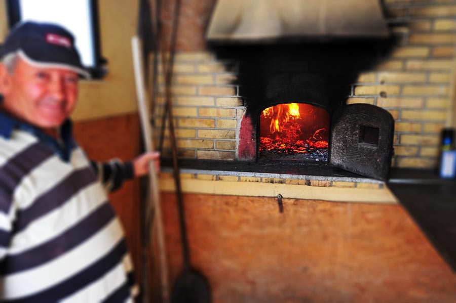 making pizza with the local pizzaiolo in our wood fired oven