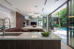 The Kitchen Opens to the Outdoor Living Areas for Maximum Entertaining