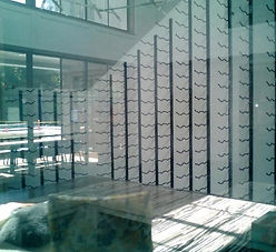 Metal wine racks within glass enclosure