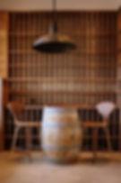Walnut wine racks with wine barrel centerpiece