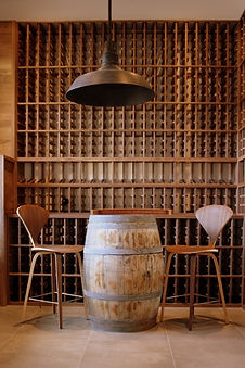 Walnut wine racks with wine barrel centerpiece