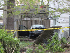 Car Jumps Curb Plows into Backyard in Germantown