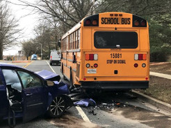 Toyota Collides with Empty School Bus