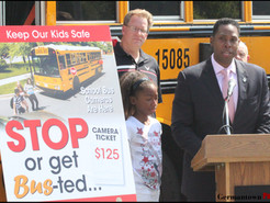 Craig Rice and Daughter Join County Officials in Urging Drivers to Stop for School Buses
