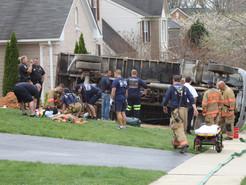 Dump Truck Flips Between Houses