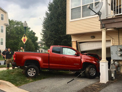 Pickup Slams into Townhouse Forces Evacuation