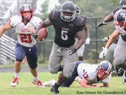 Once the Storm Passed, the Jags Ran Over Wootton in Opener