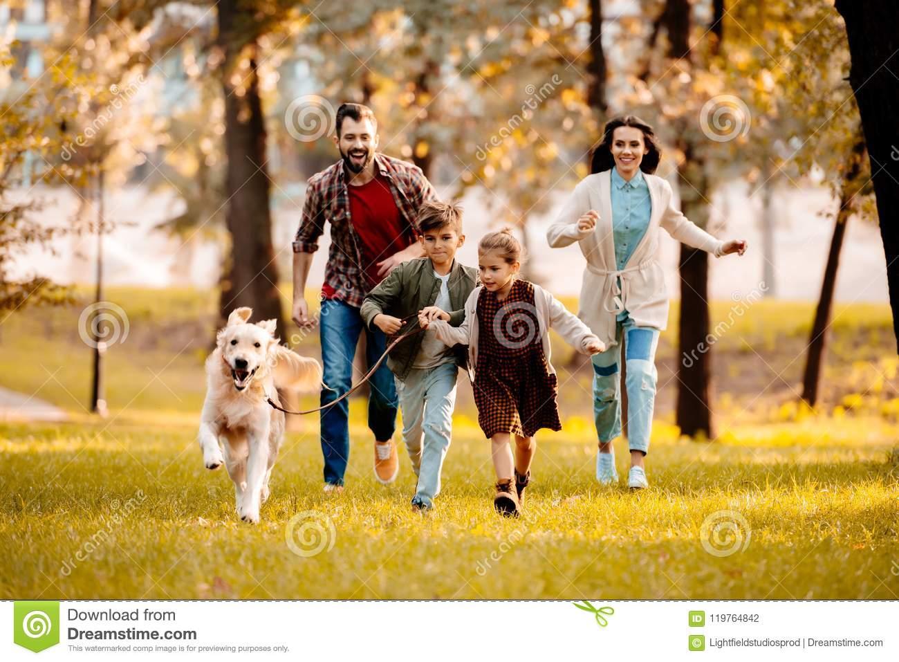 happy-family-two-children-running-dog-to