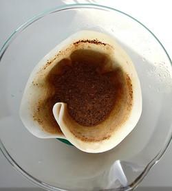Sunken, level coffee grounds